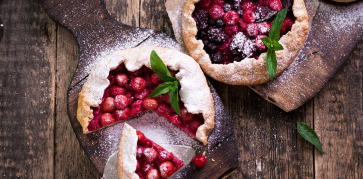 stock-photo-blueberry-cherry-raspberry-and-blackcurrant-galette-on-wooden-background-4689939562