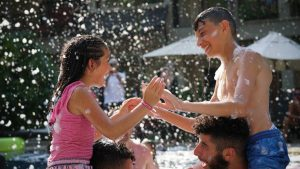 Kids playing in the lagoon swimming pool during the foam party