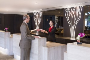 Guest checking-in with a hostess at the Reception
