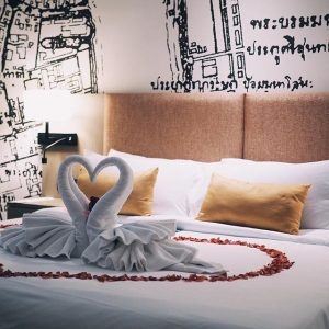 Honeymoon set up on the bed with rose petals