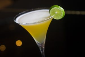 Whiskey cocktail with a lime slice