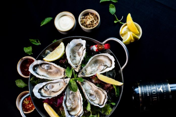 free-flow-wine-cheese-oysters