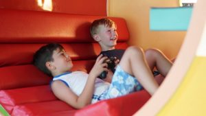 Kids enjoying Playstation 4 at Kids World