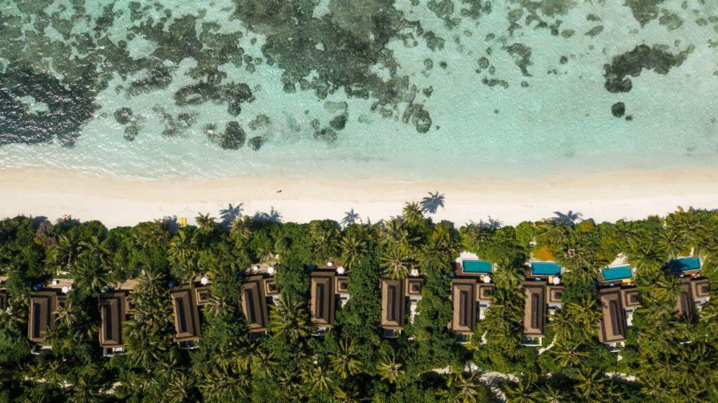 Beach villas aerial | Pullman Maldives Maamutaa