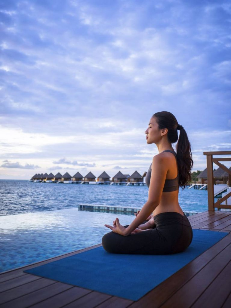 Yoga at Sunrise overwater pool villa