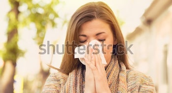 woman-allergy-symptoms-blowing-nose-600w-670193734