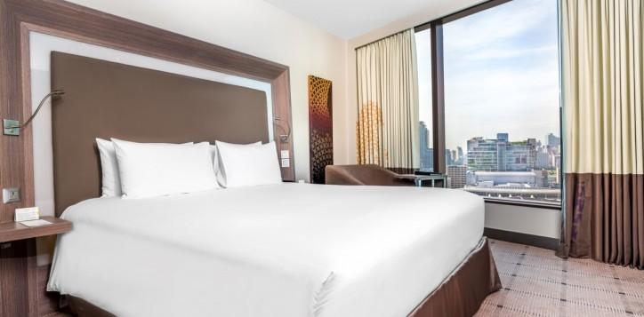 rooms-exec-suite-bedroom_1920x1080