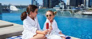 Children relaxing at outdoor infinity pool at Sofitel Sydney Darling Harbour