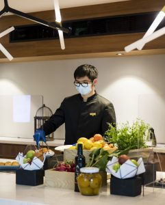 Banquet attendant wearing face mask as part of ALLSAFE / Covid-safe procedure
