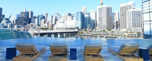 Outdoor infinity pool at Sofitel Sydney darling Harbour, overlooking the city skyline