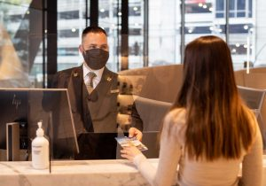 Concierge wearing face mask as part of ALLSAFE / Covid-safe procedure