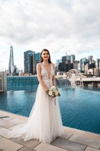 Beautiful bride by the infinity pool in Sofitel Sydney Darling Harbour