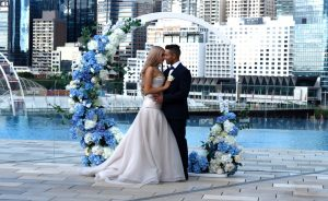 Wedding couple by the infinity pool at Sofitel Sydney Darling Harbour